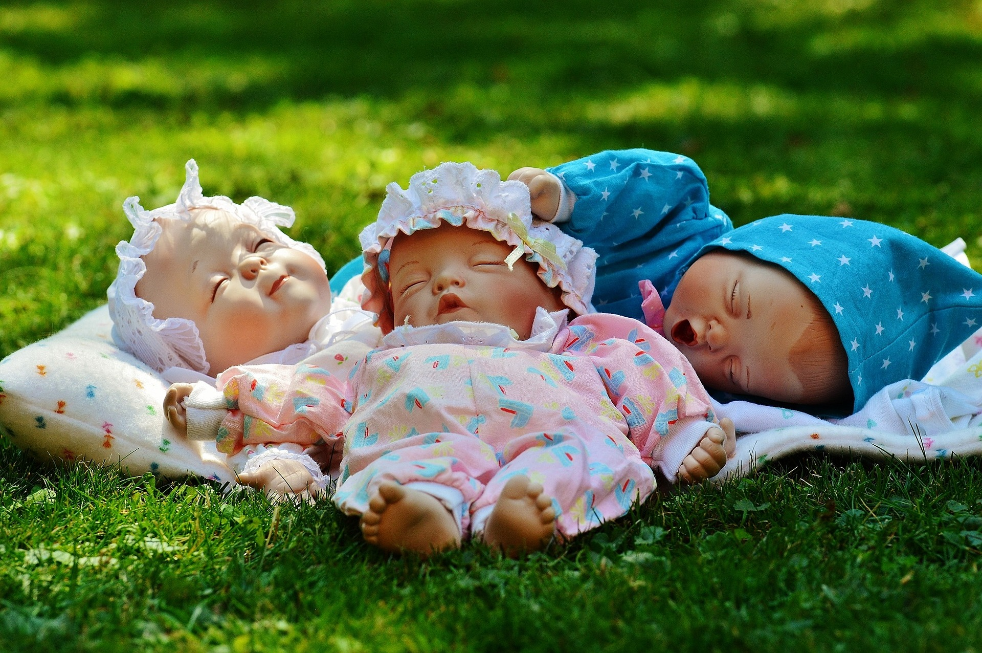 unique baby shower games. and image of 3 baby dolls to represent the unique baby shower game who's watching the baby.