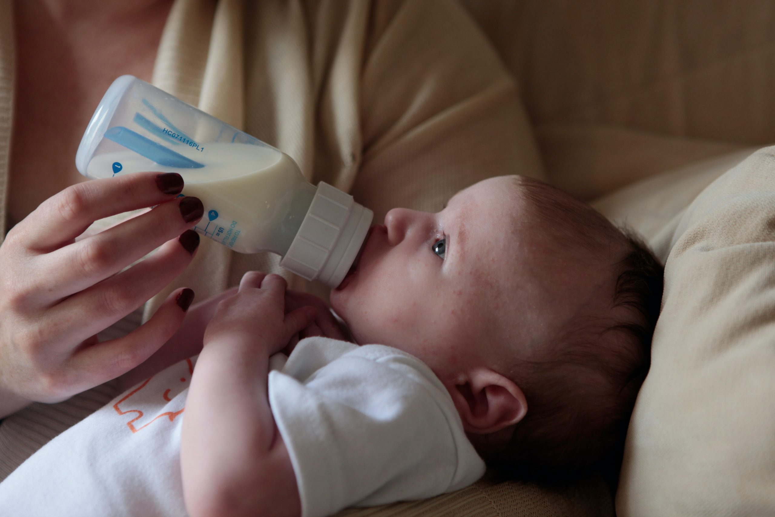 Image of a baby feeding from a bottle to represent our article entitled BabyBety's Top Picks For The Best Baby Products You Need